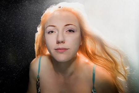 Underwater portrait of a blond hair woman Stock Photo