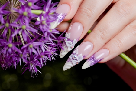 Female hand with fancy manicure