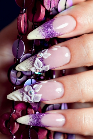 Beautiful flowery manicure in purple