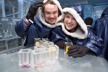 igloo: Couple having fun in ice-bar Stock Photo