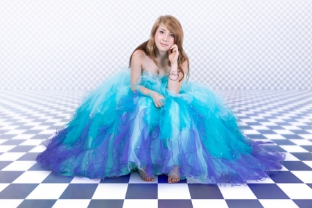Young woman in a beautiful blue tulle dress photo