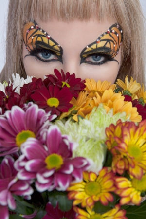 Butterfly eye makeup and beautiful flowers photo