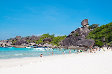 december 21: Phuket, Thailand - December 21, 2015: Beautiful view of tropical paradise beach with rocks and green exotic foliage