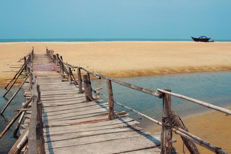 Bridge on a beach under the blue sky Stock Photo