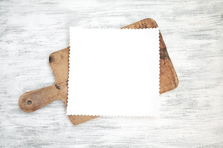 Blank Paper Sheet on Kitchen Table Stock Photo