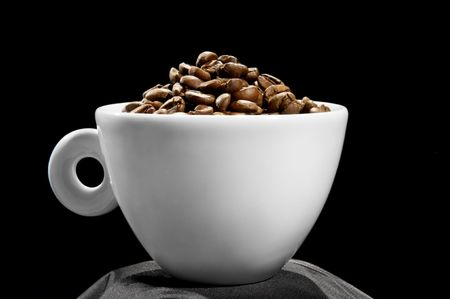 Cup with coffee grains, isolated on a black background Stock Photo - 8177277