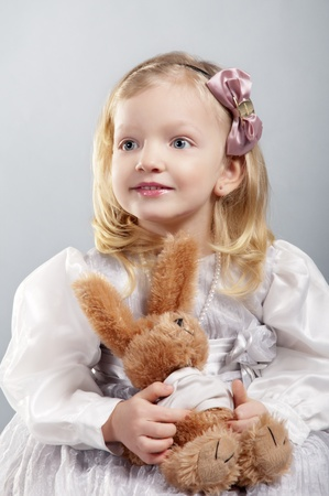 adorable smiling girl 4 years old holds teddy bear photo