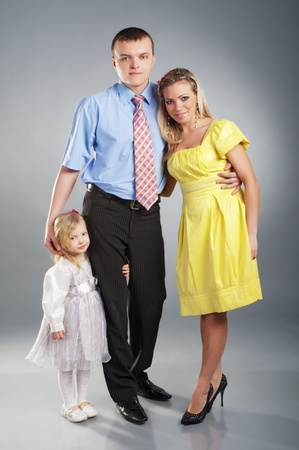 Portrait of a young happy family with the kid Stock Photo - 8887160