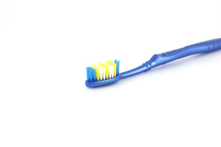Tooth-brush with blue handle over white