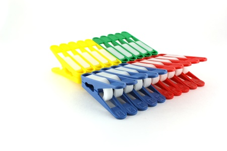 Set of color clothes-pegs over white photo