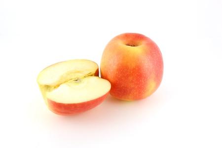 Ripe red apple on white