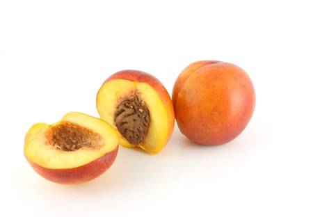 Ripe peaches on the white background