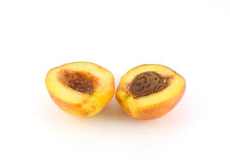 Ripe peaches over white