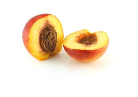 Ripe peaches on the white background Stock Photo