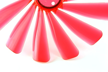 Fragment of red propeller with shadows on the white background Stock Photo