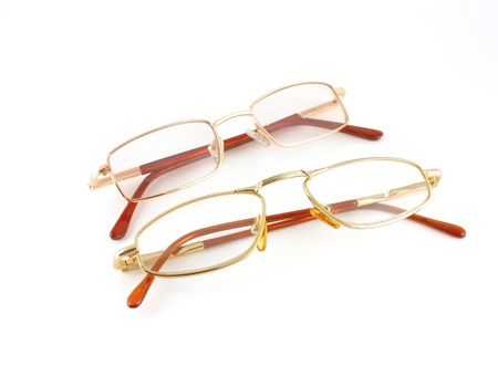 Golden glasses isolated on white