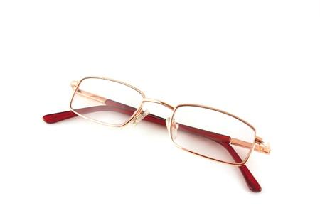 Golden optical glasses isolated on white Stock Photo