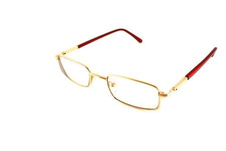 Golden optical glasses isolated on white Stock Photo