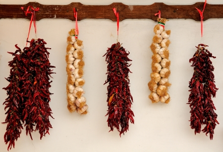 flavouring: Garlic and red chili tied in a traditional string  Hot and spicy flavouring ingredients used in worldwide cuisine