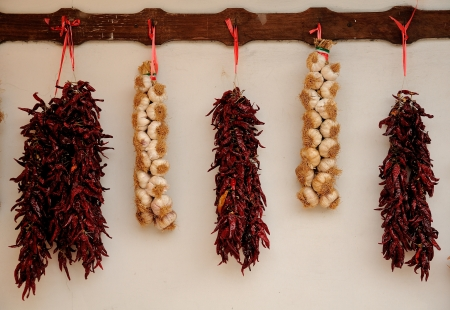 Garlic and red chili tied in a traditional string  Hot and spicy flavouring ingredients used in worldwide cuisine photo