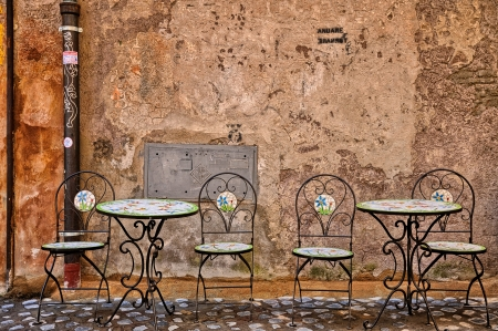 Iron tables and chairs in rome little street