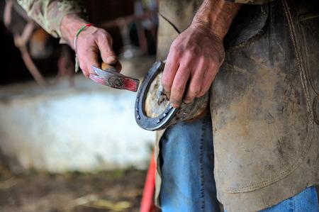 forgeman: Blacksmith in action Stock Photo