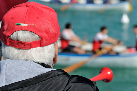 cano: referee canoe race with red cap