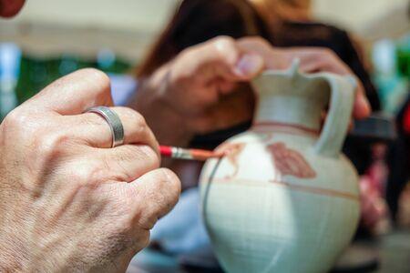 paint crock pots handmade work Stock Photo