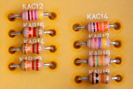 resistors: eight small, colored resistors photographed in close-up  Stock Photo