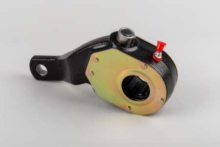 Slack adjuster.Brake slack adjuster on the gray background. Truck parts. Car parts. Parts on the gray background. Ratchet.