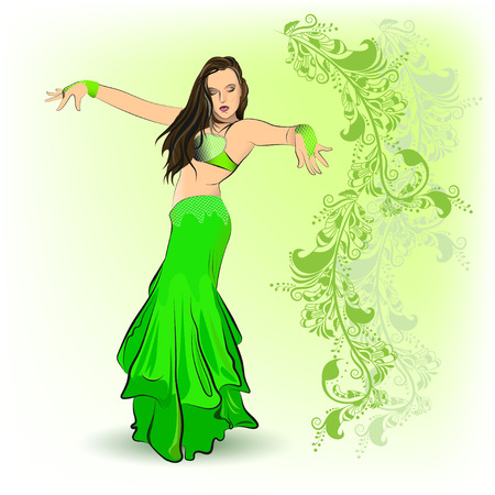 La danza del vientre en el traje verde en el fondo adornos orientales en tonos verdes.