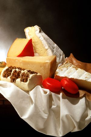 fatten: still life of several kinds of cheese (parmesan,  with walnuts, etc)