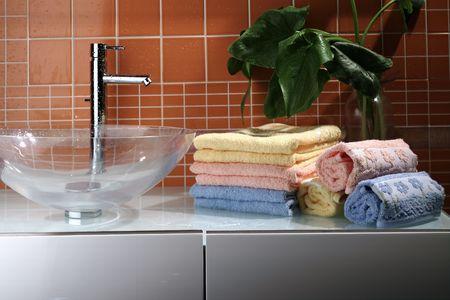 bathrobe: towels on sink
