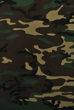 Close up camouflage fabric in a vertical orientation Stock Photo