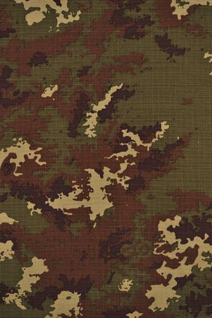 Close up camouflage fabric in a vertical orientation photo