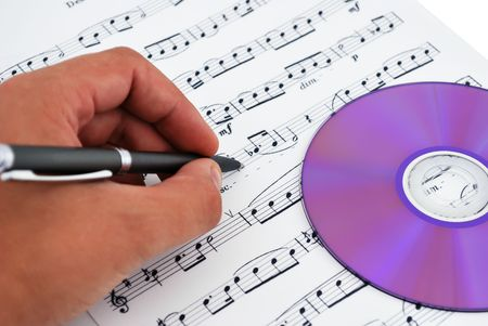 cd or dvd drive, musical notes and hand make notes photo