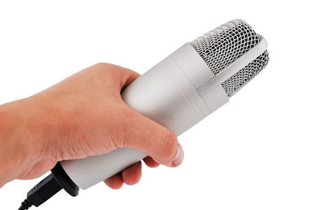 professional microphone in hand on a white background photo