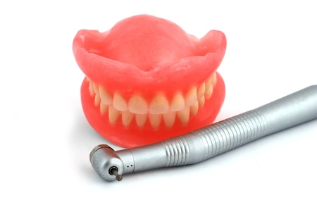 dentures and handpiece on white background Stock Photo - 8489048