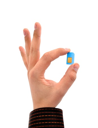 sim card in your hand on a white background photo