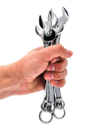 wrench in his hand on a white background photo