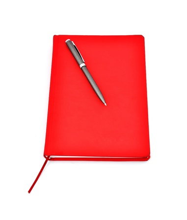 Red diary and pen on a white background