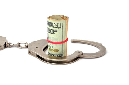 handcuffs and dollars on a white background photo