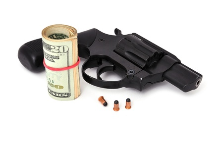 revolver and dollars on a white background photo