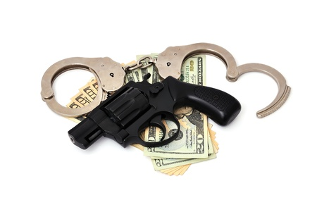 revolver,  dollars and the handcuffs on a white background photo