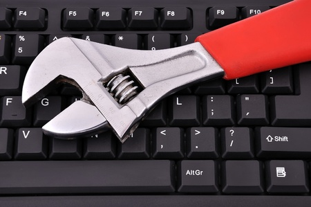 keyboard and wrench on white background