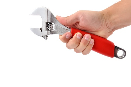 wrench in his hand on a white background Stock Photo