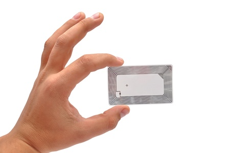rfid: RFID tag in hand  on a white background