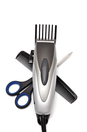 hair shaver, comb and scissors   on white background photo