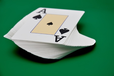 deck of cards  on a green background photo