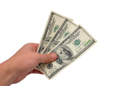 Dollars in hand on white background Stock Photo